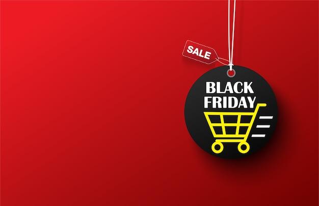 Vendita di carrello della spesa etichetta venerdì nero su sfondo rosso.