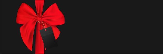 Modello di banner con fiocco rosso e cartellino del prezzo del venerdì nero