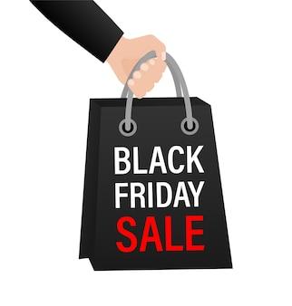 Pacchetto vendita venerdì nero con mano su bianco