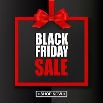 Testo di vendita venerdì nero con cornice rossa e fiocco su sfondo nero