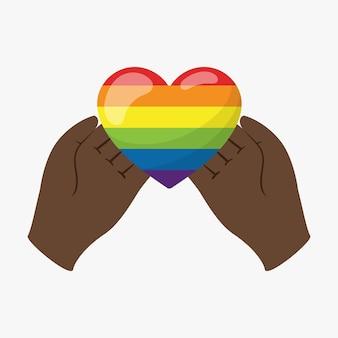 Le mani nere tengono un cuore nei colori dell'arcobaleno lgbt sui palmi delle mani. un simbolo di tolleranza e solidarietà