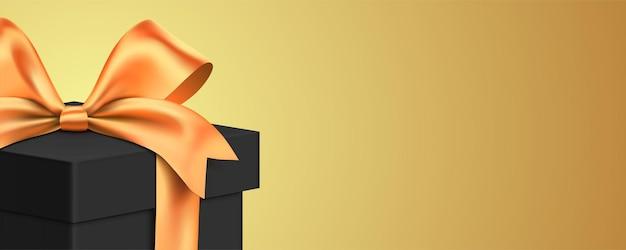 Elegante confezione regalo nera su sfondo dorato