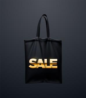 Borsa nera con cartello saldi dorati. borsa riutilizzabile in tessuto. borsa shopping in tela realistica.