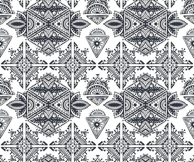 Modello senza cuciture tribale etnico in bianco e nero con elementi disegnati a mano.