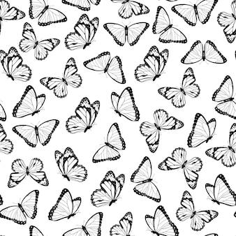 Modello senza cuciture di farfalle volanti in bianco e nero. isolato su sfondo bianco. .