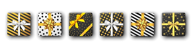 Confezione regalo in bianco e nero con nastro argento e dorato e fiocco vista dall'alto