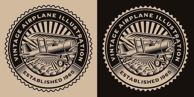Emblema rotondo bianco e nero con un aeroplano vintage