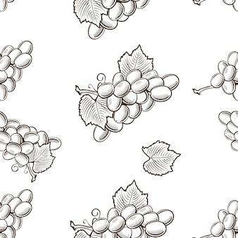 Modello senza cuciture in bianco e nero con uva in stile vintage