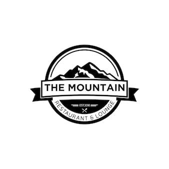 Logo del ristorante vintage in bianco e nero con cucchiaio di montagna e cucchiaio