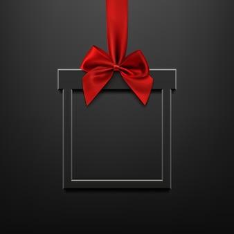 Banner vuoto, nero, quadrato a forma di regalo di natale con nastro rosso e fiocco, sfondo illuminato nero. brochure o modello di banner.