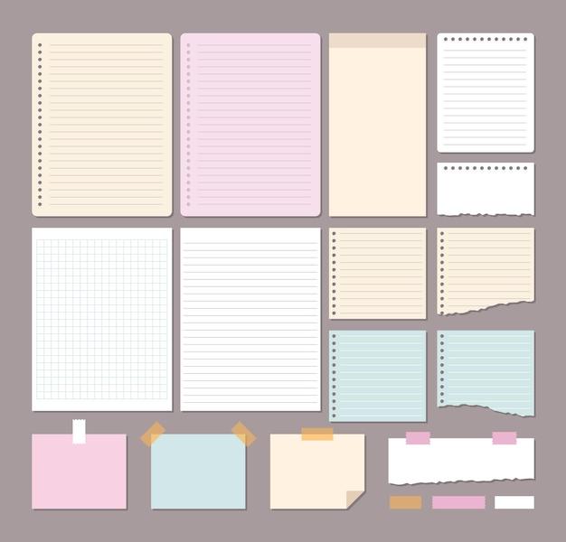 Fogli di carta bianca di diverse dimensioni e forma isolati su sfondo grigio