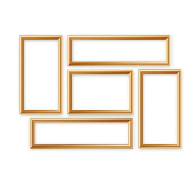 Insieme in bianco della composizione nel modello della cornice isolato sul fondo della parete