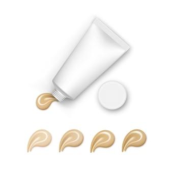 Tubo vuoto con tavolozza di cream foundation su bianco