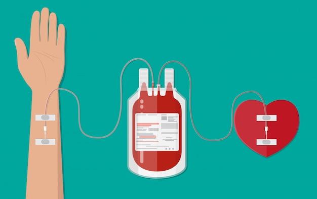 Sacca di sangue e mano del donatore con cuore