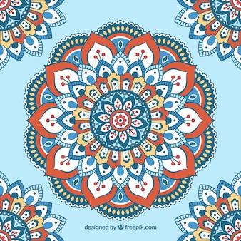 Sfondo blu con mandalas piani