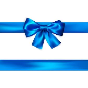 Fiocco blu con nastro isolato. fiocco di seta realistico.
