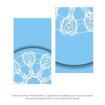 Un biglietto da visita blu con un lussuoso motivo bianco per i tuoi contatti.