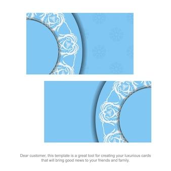 Biglietto da visita di colore blu con motivo bianco vintage per il tuo business.