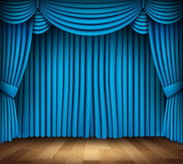 Tenda blu del teatro classico con pavimento in legno