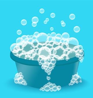 Bacinella di plastica blu con schiuma di sapone. ciotola con bolle su sfondo blu. illustrazione vettoriale. concetto di lavanderia, attrezzature per la pulizia.