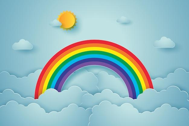 Cielo azzurro con arcobaleno e nuvole, stile paper art