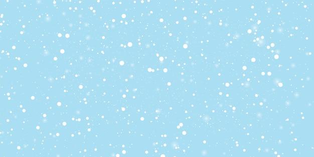 Sfondo blu neve. cielo invernale. fiocchi di neve bianchi. sfondo azzurro dello spazio. nuovo anno. nevicate invernali. neve che cade.