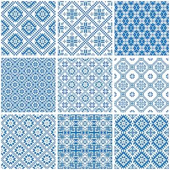 Modelli senza cuciture etnici ornamentali blu e bianchi