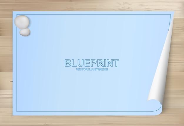 Blueprint paper background per il disegno architettonico su uno sfondo di legno