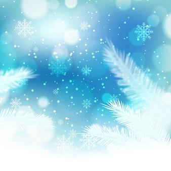 Bellissimi fiocchi di neve e pino sfocati