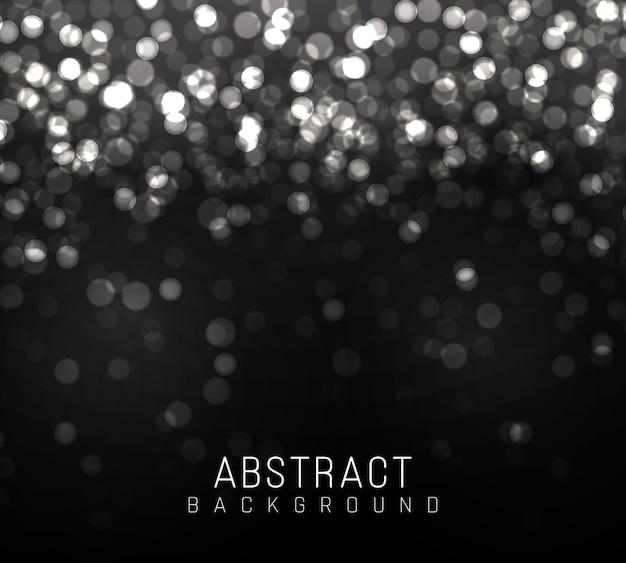 Luce offuscata del bokeh su fondo nero. scintillio d'argento astratto sfocato stelle lampeggianti e scintille.