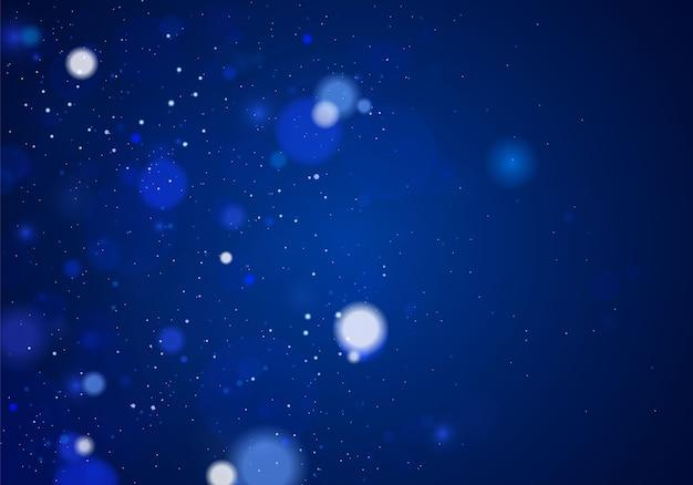 Luce bokeh sfocata su sfondo blu scuro. glitter astratto sfocato stelle lampeggianti e scintille.