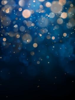 Luce offuscata del bokeh su fondo blu scuro.