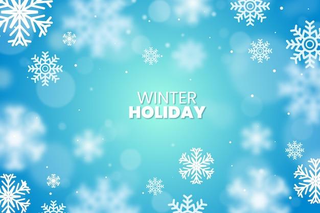 Fiocchi di neve sfocati con sfondo di testo invernale