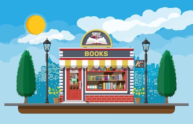 Libreria negozio esterno. negozio di libri edificio in mattoni. istruzione o mercato bibliotecario. libri in vetrina sugli scaffali.