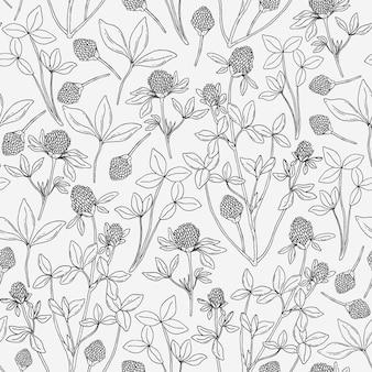 Modello senza cuciture botanico con trifoglio su sfondo bianco.