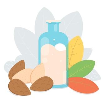 Una bottiglia di latte di mandorla con noci di mandorle nelle foglie dello scaffale e ombra sul retro