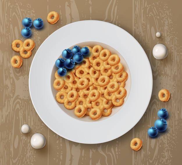 Ciotola di anelli di mais con mirtilli freschi su tavola di legno per una sana colazione vista dall'alto