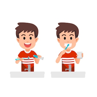 Il ragazzo si lava i denti con uno spazzolino da denti