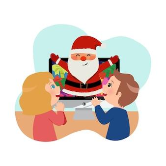 Un ragazzo e una ragazza festeggiano il natale con babbo natale tramite videochiamata. soggiorno a casa campagna per le vacanze invernali.