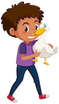 Ragazzo che tiene simpatico personaggio dei cartoni animati animale isolato su sfondo bianco