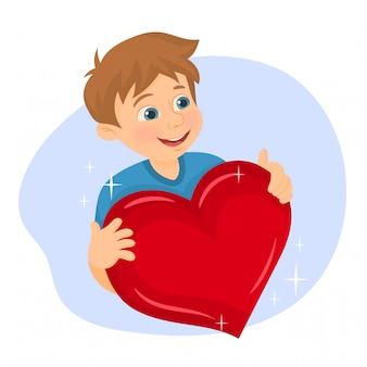 Ragazzo che tiene un cuore rosso nelle sue mani