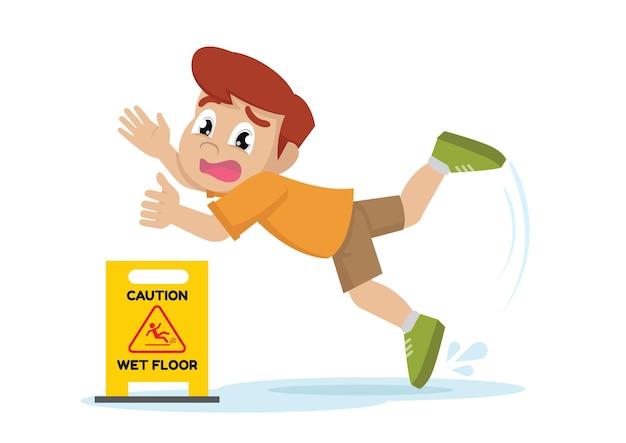 Il ragazzo è scivolato su una superficie bagnata