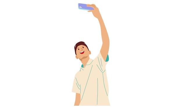 Il ragazzo prende un selfie con il telefono