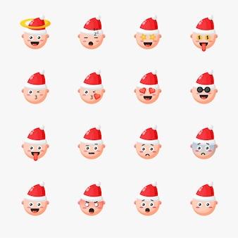 Ragazzo che indossa il cappello di natale con set di emoticon