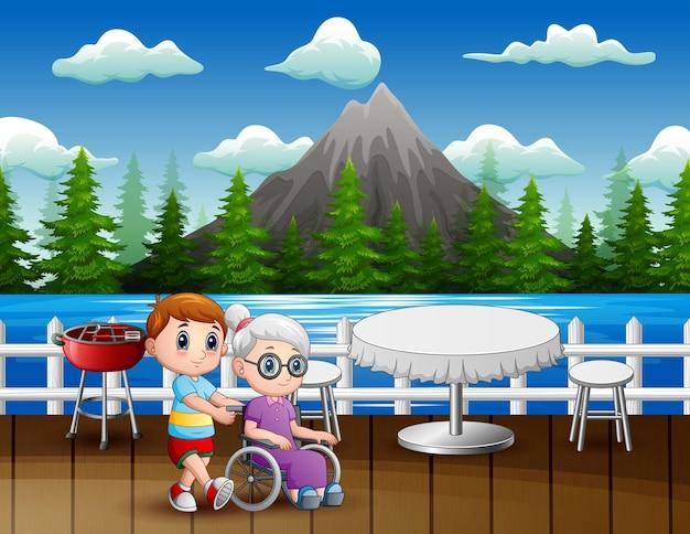 Un ragazzo con sua nonna nell'illustrazione del ristorante