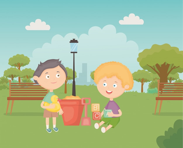 Ragazzi con benna pala nel parco, giocattoli per bambini
