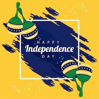 Celebrazione felice del giorno dell'indipendenza del brasile con bandiera e maracas