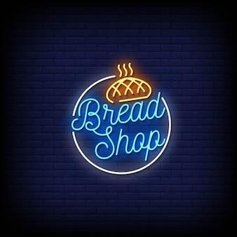 Insegna al neon del negozio di pane sul muro di mattoni