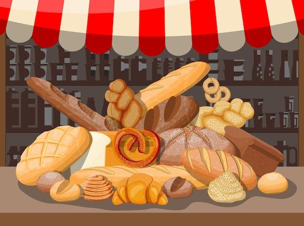 Pane in cesto di vimini e bancarella del mercato. pane integrale, grano e segale, pane tostato, pretzel, ciabatta, croissant, bagel, baguette francese, panino alla cannella.