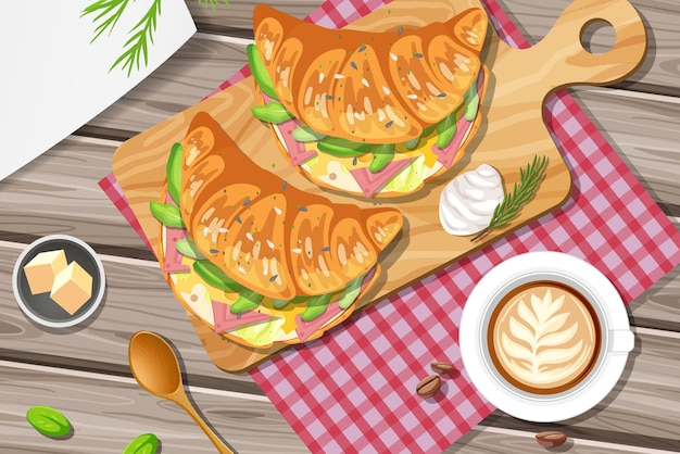 Panino con croissant per la colazione con una tazza di tè al limone sul tavolo